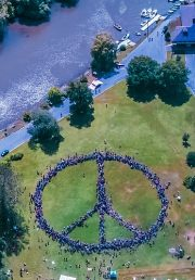 This symbolically represents an holistic approach to peacebuilding, 22 June 2008, CC BY-SA 4.0, https://en.wikipedia.org/wiki/File:Human_Peace_Sign_(2008).jpg